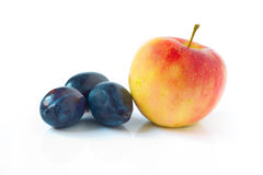 Apple and plums Stock Images
