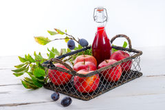 Apple plums juice Stock Photo