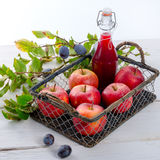Apple plums juice Royalty Free Stock Photo