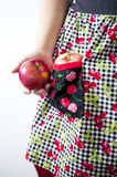 Apple in pocket of apron Royalty Free Stock Photography