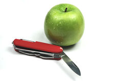 Apple and pocket knife Royalty Free Stock Image