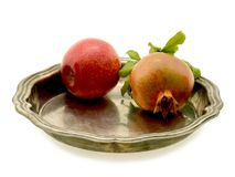 Apple and the pomegranate. Laying on a brilliant tray, on a white background Royalty Free Stock Photos