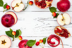 Apple, pomegranate and honey, traditional food of jewish New Year - Rosh Hashana. Copy space background. Apple, pomegranate and honey, traditional food of stock photography
