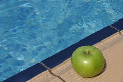 Apple at the pool Stock Photos