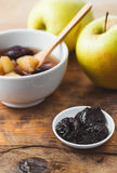 Apple & Prune Compote. Apple and prune compote, on wooden table Stock Images