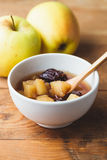 Apple & Prune Compote. Apple and prune compote, on wooden table Royalty Free Stock Image
