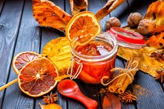 Apple-pumpkin jam with orange decorated with autumn leaves.Autumn season royalty free stock photos