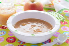 Apple puree  in bowl on colorful tablecloth Royalty Free Stock Images