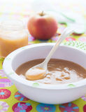 Apple puree  in bowl with spoon on colorful tablecloth Stock Photography