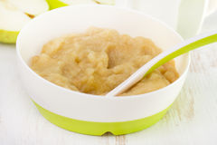 Apple puree in bowl Royalty Free Stock Image