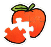 Apple puzzle. Four pieces apple puzzle Royalty Free Stock Photos