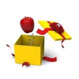 Apple que salta para fora de uma caixa de presente Fotografia de Stock Royalty Free