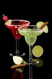 Apple and Raspberry margaritas  - Most popular coc. Apple and Raspberry margaritas in chilled glass over black background on reflection surface, garnished slice Royalty Free Stock Photography
