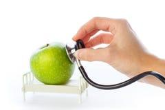 Apple reçoit le soin dans le bâti d'hôpital Photographie stock libre de droits