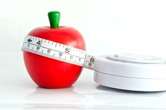Apple red color fo waist model. Measure around the waist line measure the apple Stock Images