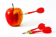 Apple with red darts Royalty Free Stock Image