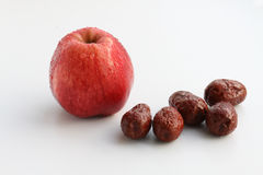 Apple and red dates Royalty Free Stock Images