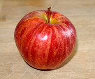 Apple red fresh and crisp delicious on a wooden table detail photograph Stock Images