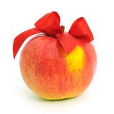 Apple and red ribbon bow Royalty Free Stock Images