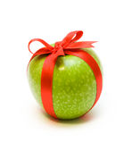 Apple in red tape. Fresh green apple packaging in red tape Royalty Free Stock Image