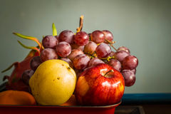 Apple in a red tray. Stock Photos