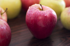 Apple. Red apple on a wooden table Stock Photos