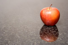 Apple reflection. Reflection of apple on marbel table Stock Photo