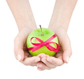 Apple with ribbon in women's hands Royalty Free Stock Images