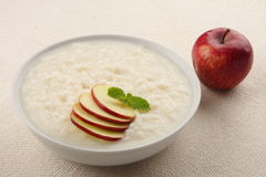 Apple and rice pudding with milk. Royalty Free Stock Image