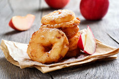 Apple rings on rustic table Stock Images
