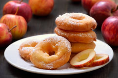 Apple rings on white plate Stock Images