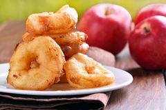 Apple rings on white plate Royalty Free Stock Photos