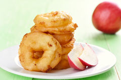 Apple rings on white plate Royalty Free Stock Photo