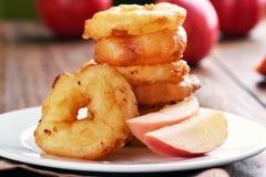 Apple rings on white plate, fruit baking Stock Images