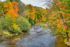 The Apple River in Autumn in Wisconsin. The Apple River in Western Wisconsin with brilliant vibrant autumn foliage stock photo