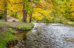 The Apple River in Autumn in Wisconsin. The Apple River in Western Wisconsin with brilliant vibrant autumn foliage stock images