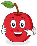 Apple rojo manosea con los dedos encima de carácter Foto de archivo