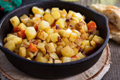 Apple and root vegetable hash. With potato, carrots and celery root royalty free stock photography