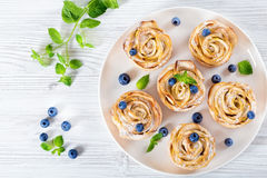 Apple rose cake or cupcake and blueberry, top view Stock Photo