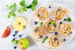 Apple rose cake or cupcake and blueberry, top view Royalty Free Stock Photography
