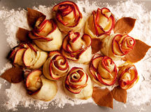 Apple rose in flour. Rose apples in flour and chocolate petals royalty free stock photos
