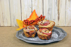 Apple rose pastry with autumn leaves Royalty Free Stock Photography