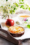 Apple rose shaped pie and cup of tea on the vintage serving tray Royalty Free Stock Photos