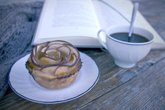 Apple rose. Take a break. Time to read a book and relax Royalty Free Stock Image