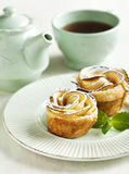 Apple roses. Cakes Apple Roses and cup of tea Royalty Free Stock Photo