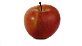 Apple rosso con la banda gialla Immagine Stock