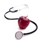 Apple rosso e uno Stethescope Fotografie Stock