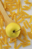 Apple and rotini pasta Royalty Free Stock Image