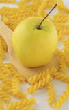 Apple and rotini pasta Stock Photography