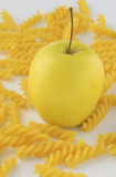 Apple and rotini pasta Stock Images